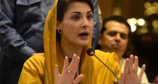 Maryam Nawaz in yellow dress talk to media
